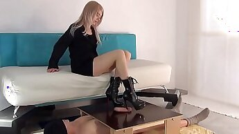 Blonde gives a mean footjob and get cummed from the back